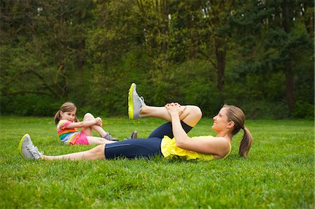 Mother and Young Daughter Exercising in the Park, Portland, Oregon, USA Stock Photo - Premium Royalty-Free, Code: 600-03563816