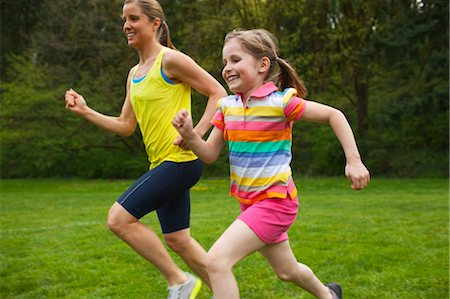 Mother and Young Daughter Exercising in the Park, Portland, Oregon, USA Stock Photo - Premium Royalty-Free, Code: 600-03563817