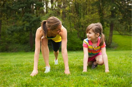 Mother and Young Daughter Exercising in the Park, Portland, Oregon, USA Stock Photo - Premium Royalty-Free, Code: 600-03563813