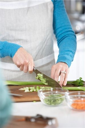 Woman Chopping Vegetables Stock Photo - Premium Royalty-Free, Code: 600-03587366
