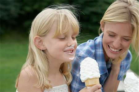 Mother and Daughter Eating Ice Cream Cones Stock Photo - Premium Royalty-Free, Code: 600-03601498
