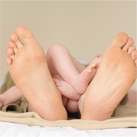 Dad and Baby's Feet Stock Photo - Premium Royalty-Free, Code: 600-03621288