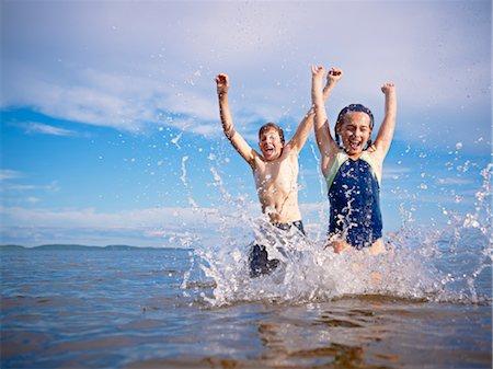 Boy and Girl Playing, Lake Wanapitei, Sudbury, Ontario, Canada Stock Photo - Premium Royalty-Free, Code: 600-03621295
