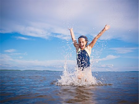 Girl Playing, Lake Wanapitei, Sudbury, Ontario, Canada Stock Photo - Premium Royalty-Free, Code: 600-03621296
