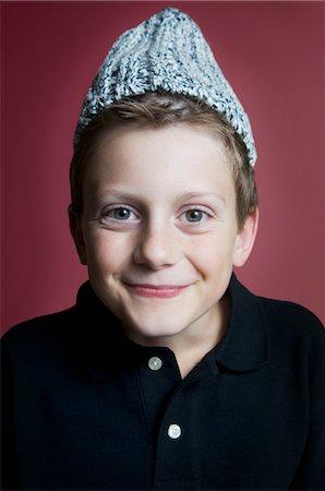 Portrait of Boy Wearing Hat Stock Photo - Premium Royalty-Free, Code: 600-03623014