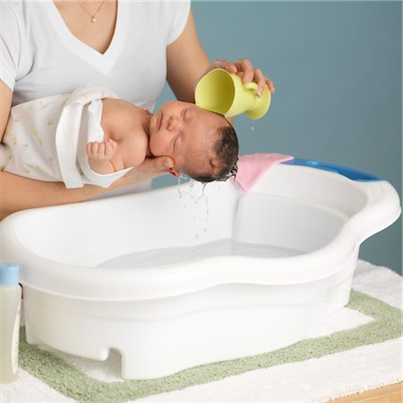 Mother Washing Newborn Baby Stock Photo - Premium Royalty-Free, Code: 600-03623037