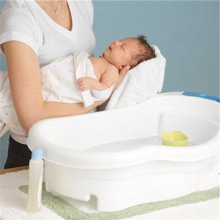 Mother Washing Newborn Baby Stock Photo - Premium Royalty-Free, Code: 600-03623038