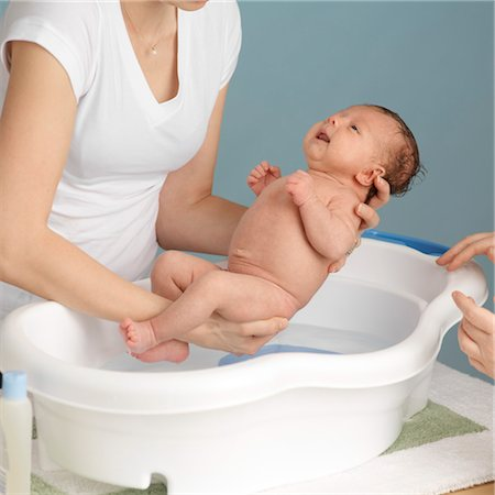 Mother Washing Newborn Baby Stock Photo - Premium Royalty-Free, Code: 600-03623039