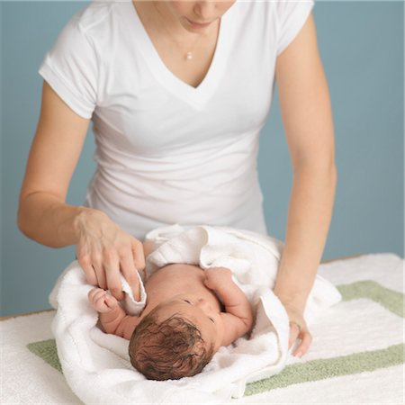 Mother Drying Newborn Baby After a Bath Stock Photo - Premium Royalty-Free, Code: 600-03623041
