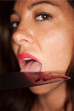 Woman Licking Blood off a Knife Stock Photo - Premium Royalty-Free, Code: 600-03638627