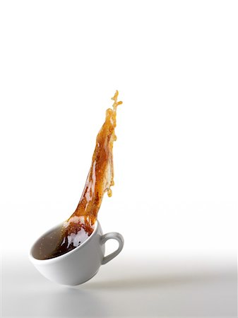 Coffee Spilling out of Coffee Cup Stock Photo - Premium Royalty-Free, Code: 600-03638698
