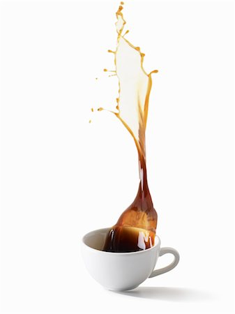 Coffee Spilling out of Coffee Cup Stock Photo - Premium Royalty-Free, Code: 600-03638699