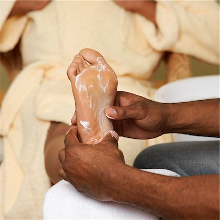 Man Massaging Woman's Foot Stock Photo - Premium Royalty-Free, Code: 600-03638841