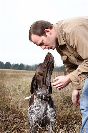dog kissing man - Dog Giving Owner a Kiss, Houston, Texas, USA Stock Photo - Premium Royalty-Free, Code: 600-03644799