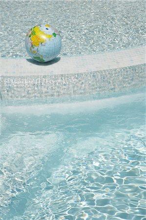 Beach Ball Globe in Swimming Pool, Sanary-sur-Mer, Var, Provence, Provence-Alpes-Cote d'Azur, France Stock Photo - Premium Royalty-Free, Code: 600-03644927