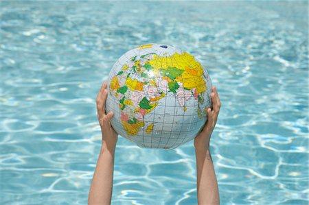 Woman Holding Inflatable Globe, Sanary-sur-Mer, Var, Provence, Provence-Alpes-Cote d'Azur, France Stock Photo - Premium Royalty-Free, Code: 600-03644928
