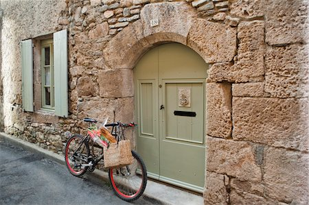 french (places and things) - Bicycle in Medieval Village, Caunes-Minervois, Aude, Languedoc-Roussillon, France Stock Photo - Premium Royalty-Free, Code: 600-03654641