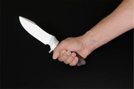 Hand Holding Knife Stock Photo - Premium Royalty-Free, Code: 600-03685871