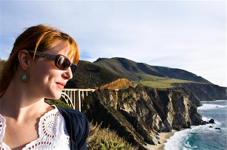 Woman Looking at View of Big Sur Coast and Santa Lucia Mountains, Monterey County, California, USA Stock Photo - Premium Royalty-Free, Code: 600-03686116