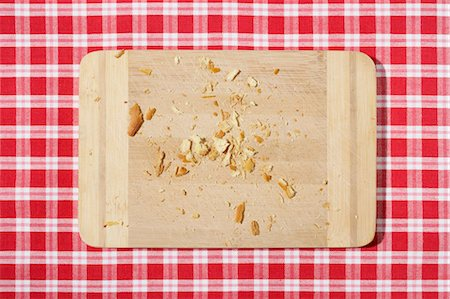 Cutting Board with Bread Crumbs Stock Photo - Premium Royalty-Free, Code: 600-03682032