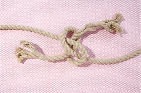 Ropes Tied in Knot Stock Photo - Premium Royalty-Free, Code: 600-03682045