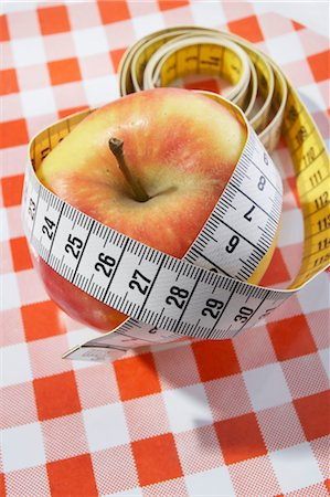 Apple with Tape Measure Stock Photo - Premium Royalty-Free, Code: 600-03682062