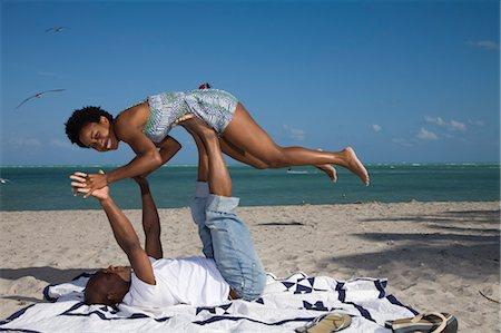 Couple Playing on the Beach, Florida, USA Stock Photo - Premium Royalty-Free, Code: 600-03682200