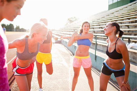 Teenagers Stretching at Race Track, Lake Oswego, Oregon, USA Stock Photo - Premium Royalty-Free, Code: 600-03696759