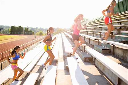 Teenagers Running up Bleachers at Race Track, Lake Oswego, Oregon, USA Stock Photo - Premium Royalty-Free, Code: 600-03696760