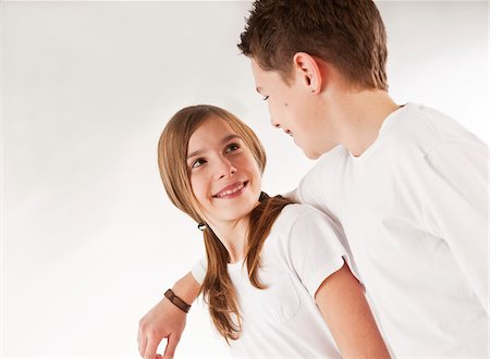 Boy with Arm around Girl Stock Photo - Premium Royalty-Free, Code: 600-03697804