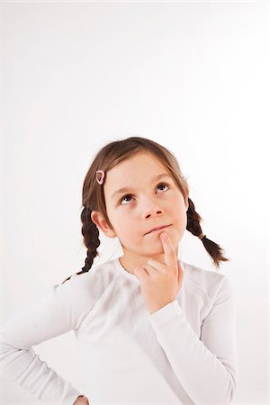 Portrait of Girl Thinking Stock Photo - Premium Royalty-Free, Code: 600-03697811