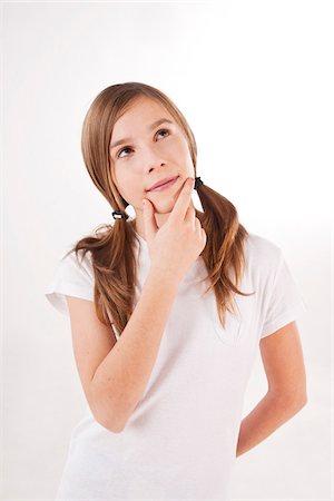 Portrait of Girl Thinking Stock Photo - Premium Royalty-Free, Code: 600-03697813