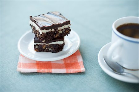 Gluten-free Nanaimo Bars and a Cup of Coffee, Vancouver, British Columbia, Canada Stock Photo - Premium Royalty-Free, Code: 600-03698374