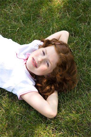 preteen girl - Little Girl Lying on the Grass Stock Photo - Premium Royalty-Free, Code: 600-03692097
