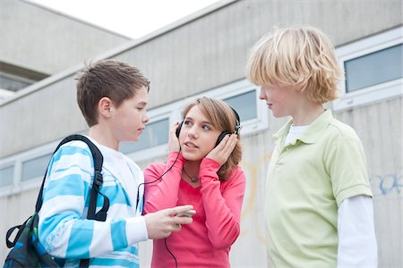 Teenagers in Schoolyard Stock Photo - Premium Royalty-Free, Code: 600-03734608