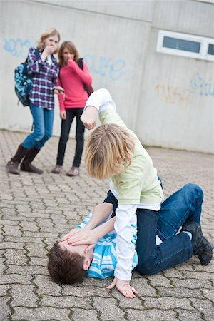 student fighting - Teenagers Fighting Stock Photo - Premium Royalty-Free, Code: 600-03734615