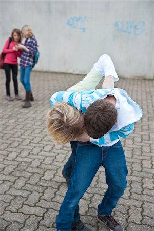 student fighting - Teenagers Fighting Stock Photo - Premium Royalty-Free, Code: 600-03734612