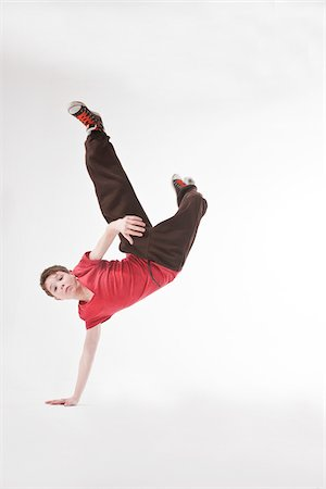 preteen dancing - Teenager doing Handstand Stock Photo - Premium Royalty-Free, Code: 600-03734636