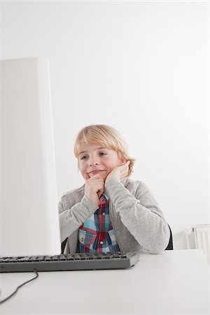 school desk - Boy Using Computer Stock Photo - Premium Royalty-Free, Code: 600-03734642