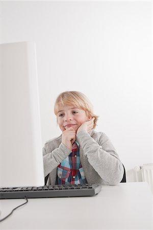 Boy Using Computer Stock Photo - Premium Royalty-Free, Code: 600-03734642