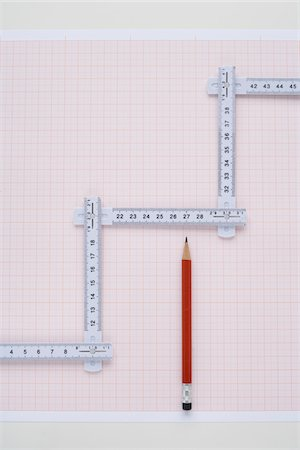 Folding Ruler, Pencil and Graph Paper Stock Photo - Premium Royalty-Free, Code: 600-03738127