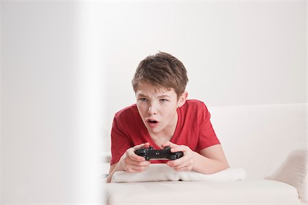 Teenage Boy Playing Video Games, Mannheim, Baden-Wurttemberg, Germany Stock Photo - Premium Royalty-Free, Code: 600-03738188