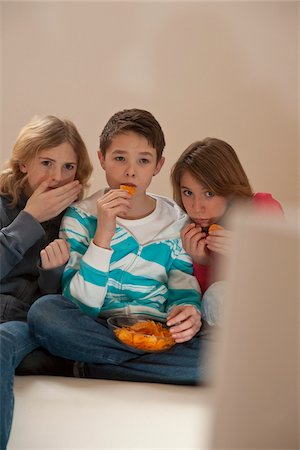 Teenagers Watching Television, Mannheim, Baden-Wurttemberg, Germany Stock Photo - Premium Royalty-Free, Code: 600-03738196