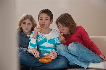 Teenagers Watching Television, Mannheim, Baden-Wurttemberg, Germany Stock Photo - Premium Royalty-Free, Code: 600-03738197