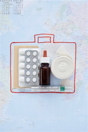 First Aid Travel Kit and Map Stock Photo - Premium Royalty-Free, Code: 600-03738804