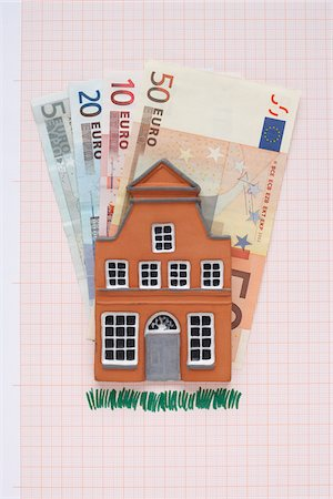 House and Euros on Graph Paper Stock Photo - Premium Royalty-Free, Code: 600-03738815