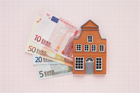 House and Euros on Graph Paper Stock Photo - Premium Royalty-Free, Code: 600-03738820