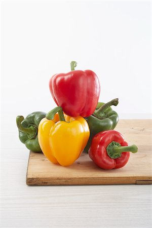 five - Peppers on Cutting Board Stock Photo - Premium Royalty-Free, Code: 600-03762579