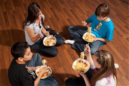 Children Eating Pasta Stock Photo - Premium Royalty-Free, Code: 600-03799496