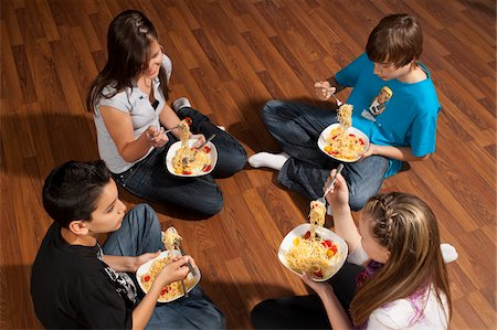 Children Eating Pasta Stock Photo - Premium Royalty-Free, Code: 600-03799496